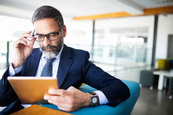 Shot of thinking financial advisor businessman working in office - Stock Photo - Images