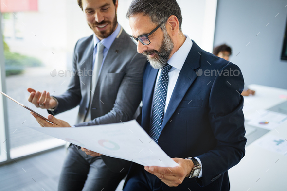 Business people having fun and chatting at workplace office - Stock Photo - Images