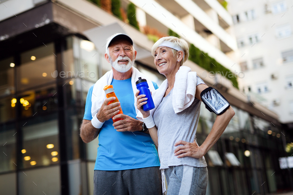 Healthy senior, couple jogging in the city at early morning with sunrise - Stock Photo - Images