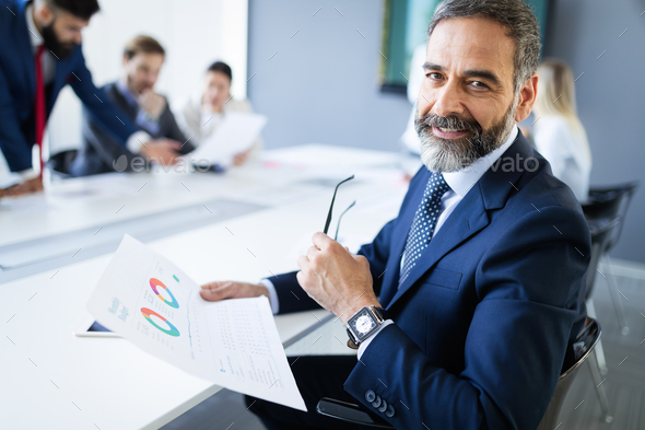 Confident senior businessman leader working in office - Stock Photo - Images