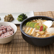 Delicious Korean food - kind of noodles, soup with rice and side dish with fish on the table. 062 - PhotoDune Item for Sale