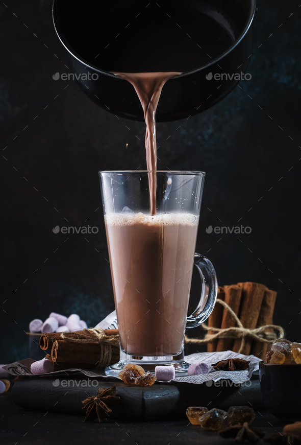 Pouring winter hot chocolate cocoa drink - Stock Photo - Images