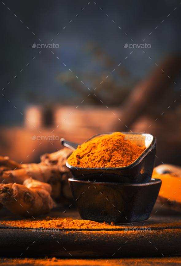 Turmeric powder and fresh turmeric - Stock Photo - Images