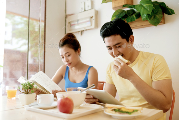 Couple eating breakfast - Stock Photo - Images