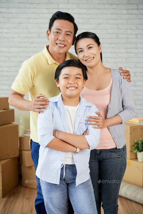 Asian Family Moving to New Apartment - Stock Photo - Images