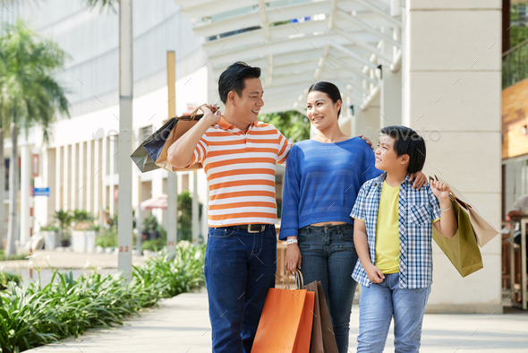 Asian Family with Shopping Bags - Stock Photo - Images