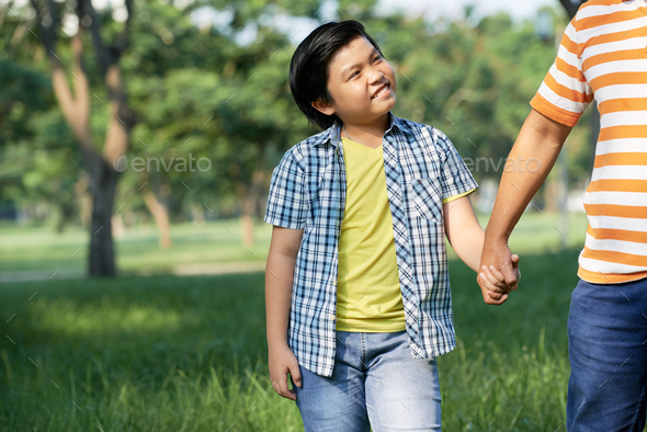 Enjoying Pleasant Walk with Loving Dad - Stock Photo - Images
