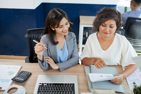Discussing business data - Stock Photo - Images
