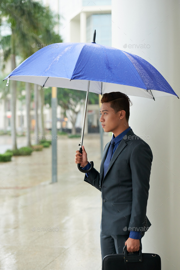 Handsome Asian Businessman with Umbrella - Stock Photo - Images