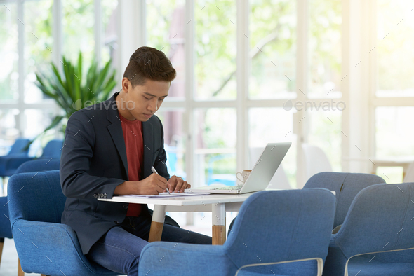 Young Entrepreneur Preparing for Negotiations - Stock Photo - Images