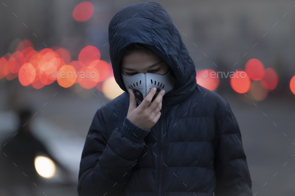 Young Person wearing Anti-Pollution Mask, Polluted Air, City Street - Stock Photo - Images