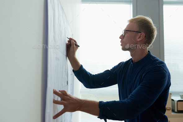 Correcting building plan - Stock Photo - Images