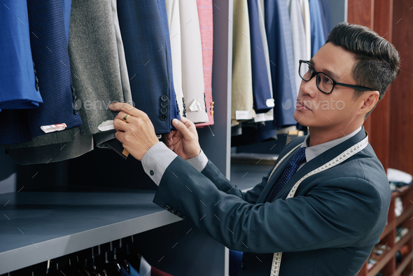 Salesman working in store - Stock Photo - Images