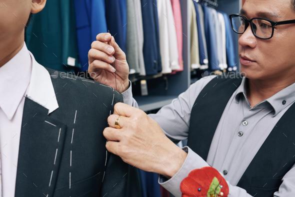 Fashion designer making jacket - Stock Photo - Images