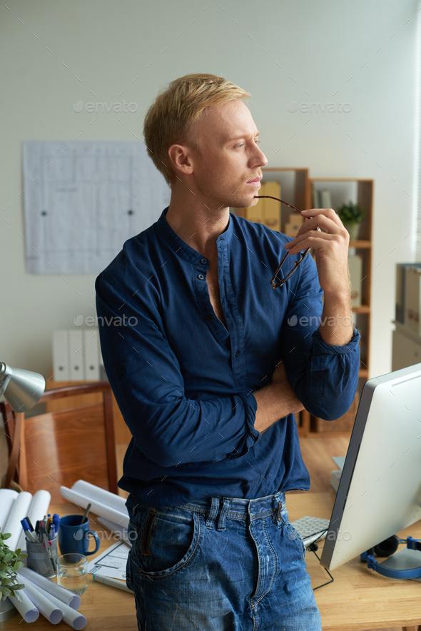 Pensive architect - Stock Photo - Images