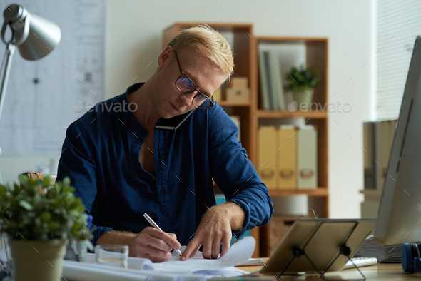 Architect talking to client - Stock Photo - Images