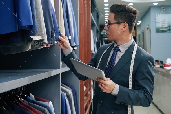 Checking shop assortment - Stock Photo - Images