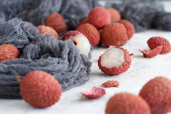 Fresh litchi fruits on a white table - Stock Photo - Images