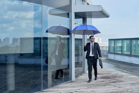 Businessman hurrying to work - Stock Photo - Images