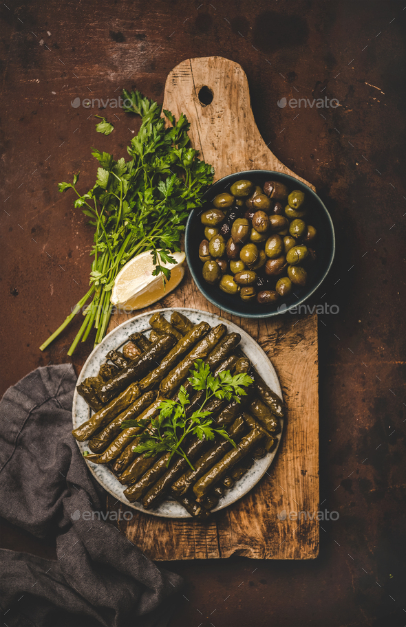 Flat-lay of traditional turkish Dolma meze or snack on board - Stock Photo - Images