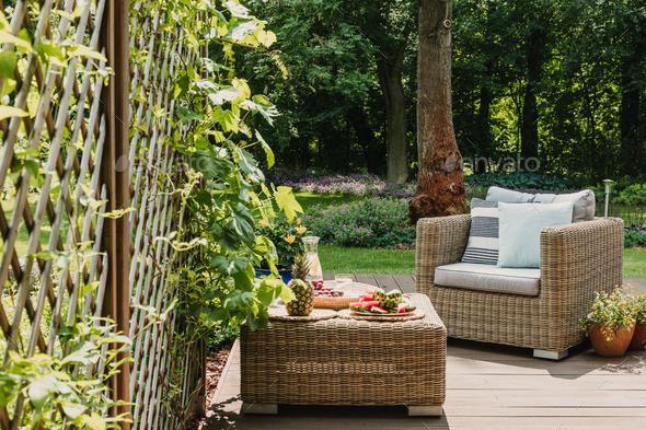 Elegant garden furniture on terrace of suburban home - Stock Photo - Images