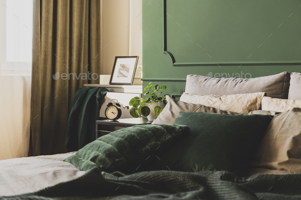 Dark green trendy interior design in fashionable apartment, copy space on empty wall - Stock Photo - Images