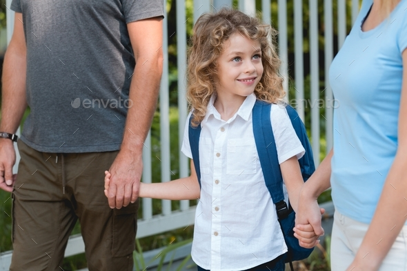 Parents walking to school - Stock Photo - Images