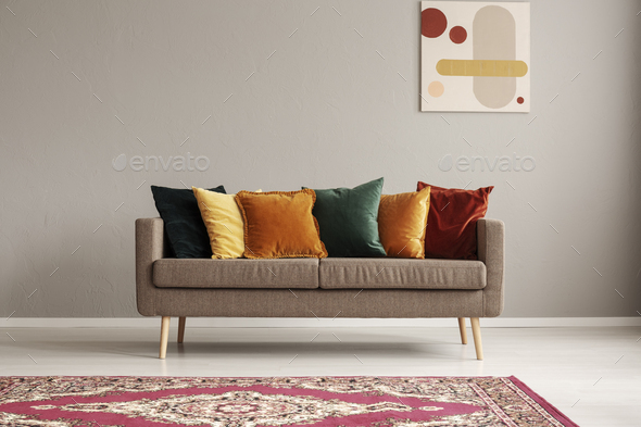 Vintage style grey living room interior with trendy sofa - Stock Photo - Images