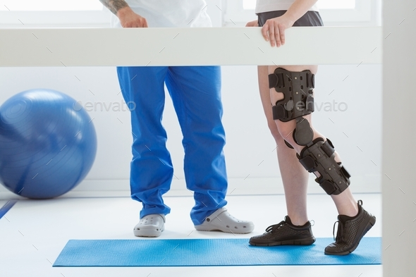Patient and physiotherapist at the first appointment in orthopedic clinics - Stock Photo - Images