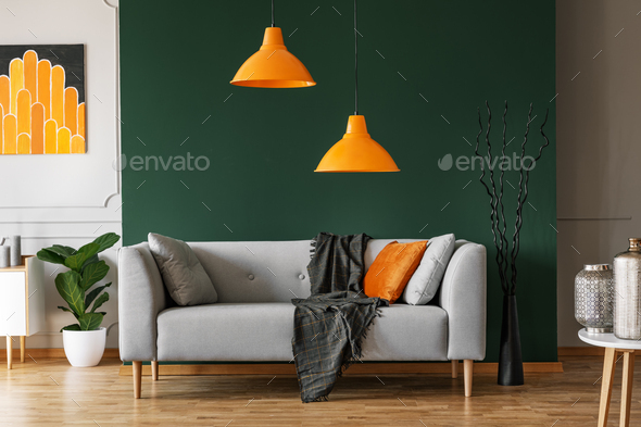 Pillows on comfortable sofa in bright living room interior - Stock Photo - Images