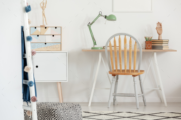 Industrial mint colored lamp on stylish wooden desk in white kid's bedroom - Stock Photo - Images