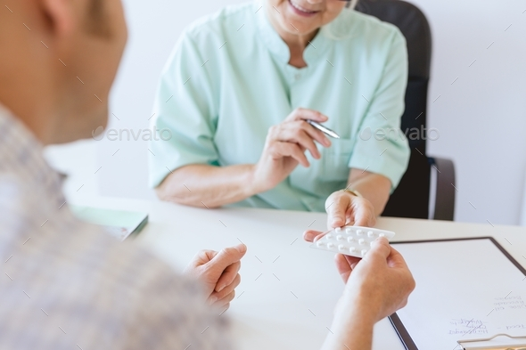 Doctor giving the pills - Stock Photo - Images