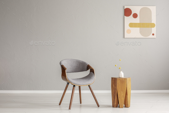 Stylish grey wooden chair in empty living room interior with trendy wooden coffee table - Stock Photo - Images