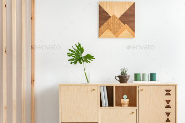 Stylish wooden design in trendy scandinavian apartment with white wall - Stock Photo - Images