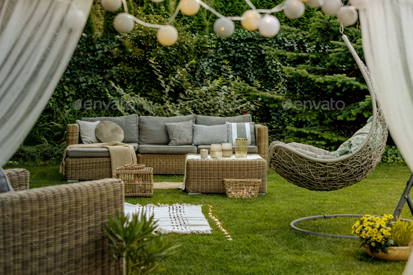 Cozy sofa set in the garden - Stock Photo - Images