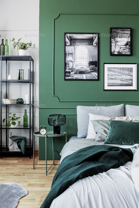 Stylish bedroom interior with double bed and emerald green wall - Stock Photo - Images
