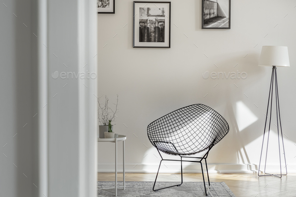 Fancy black metal chair in bright room in tenement house - Stock Photo - Images