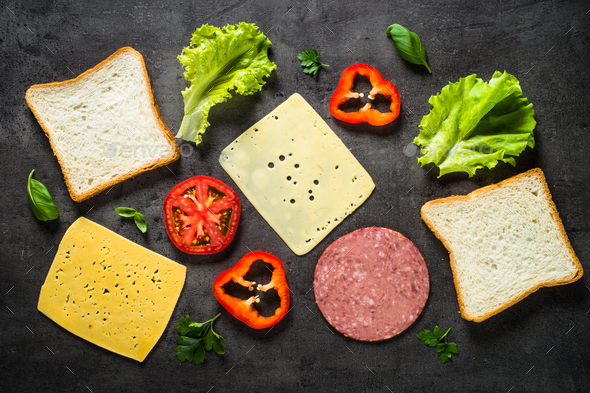Ingredients for sandwich on a black background - Stock Photo - Images
