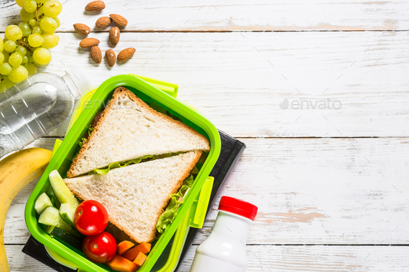 Lunch box with sandwich, vegetables, yogurt, nuts and berries - Stock Photo - Images