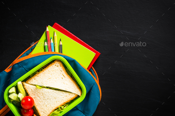 Back to school concept. Lunch box, stationery and backpack - Stock Photo - Images