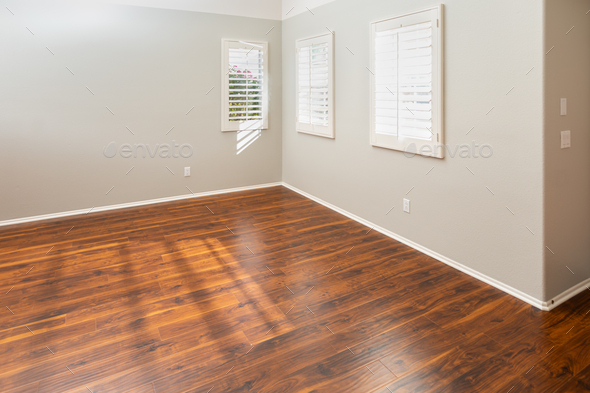 Newly Installed Brown Laminate Flooring and Baseboards in Home - Stock Photo - Images