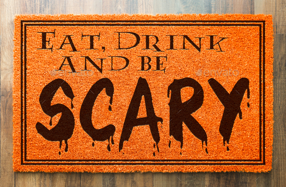 Eat, Drink and Be Scary Halloween Orange Welcome Mat On Wood Floor Background - Stock Photo - Images