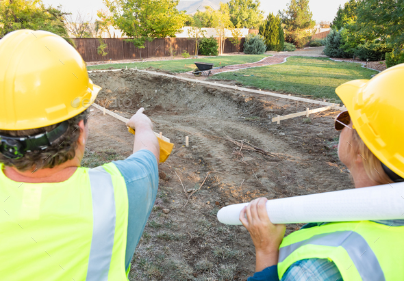 Male and Female Workers Overlooking Pool Construction Site - Stock Photo - Images