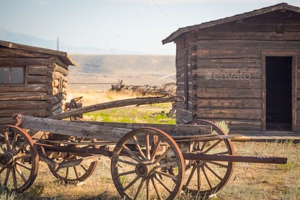 Abstract of Vintage Antique Wood Wagon and Log Cabins. - Stock Photo - Images
