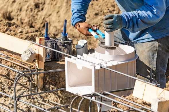 Plumber Using Wrench to Install PVC Pipe at Construction Site - Stock Photo - Images