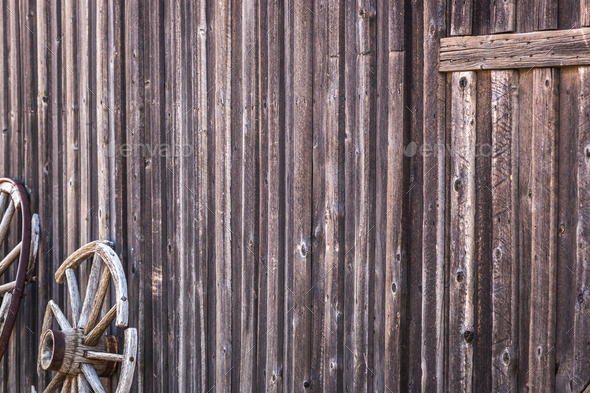 Abstract of Vintage Antique Log Cabin Wall and Wagon Wheel. - Stock Photo - Images