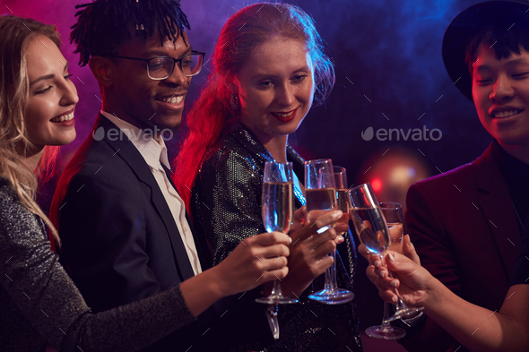 Friends Drinking Champagne in Nightclub - Stock Photo - Images