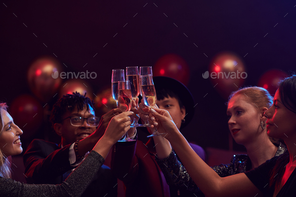 Friends Raising Champagne Glasses in Nightclub - Stock Photo - Images