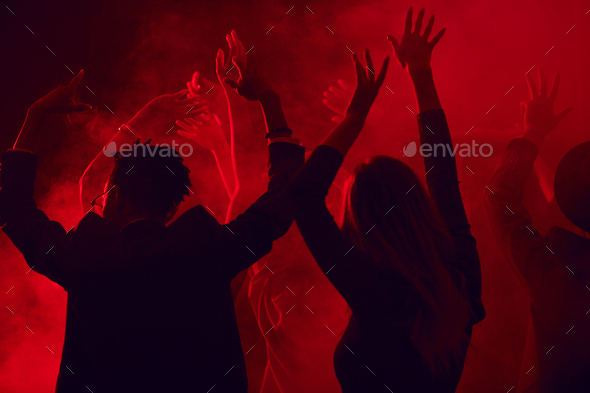 Crowd Dancing in Red Nightclub - Stock Photo - Images