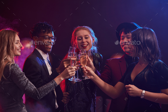 Young People Celebrating in Nightclub - Stock Photo - Images